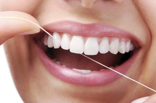 Peak Dental Arts - Flossing | Peak Dental Arts - North Vancouver